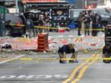 Federal Bureau of Investigation (FBI) officials mark the ground near the site of an explosion in the Chelsea neighborhood of Manhattan, New York, U.S.  September 18, 2016. PHOTO: REUTERS