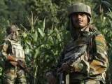 Indian army soldiers patrol near the Line of Control, a ceasefire line dividing Kashmir between India and Pakistan, in Poonch district in this August 7, 2013 file photo. PHOTO: REUTERS/FILE