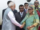 Bangladeshi Prime Minister, Sheikh Hasina Wajid (R) welcomes her Indian counterpart, Narendra Modi (L) at the Hazrat Shahjalal International Airport in Dhaka on June 6, 2015.  PHOTO: AFP