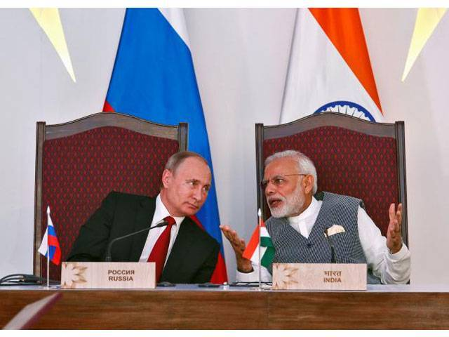 India's Prime Minister Narendra Modi (R) speaks with Russian President Vladimir Putin during exchange of agreements event after India-Russia Annual Summit in Benaulim, in the western state of Goa, India, October 15, 2016. PHOTO: REUTERS
