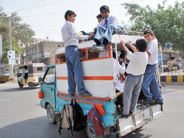 A number of school children travel in a van Hyderabad. Parents of certain students in Karachi approached the court against what they saw as an unjustified increase in school fee. PHOTO: ONLINE