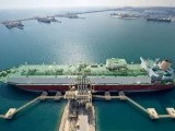 A ship loads up with liquid natural gas, of which Qatar is the world's biggest exporter. PHOTO SOURCE: QATAR PETROLEUM