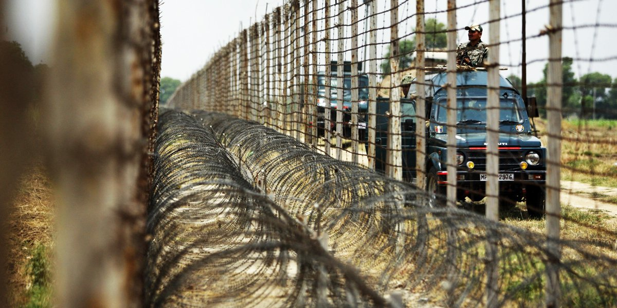 Indian Border Security Force soldiers patrol near the India-Pakistan international border fence. PHOTO: AP