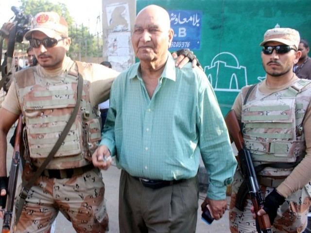 Rangers personnel detain Muttahida Qaumi Movement (MQM) London leader Dr Hasan Zafar Arif from outside the Karachi Press Club on October 22, 2016. PHOTO: PPI