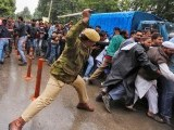 Indian police vs Srinagar strikers. PHOTO: REUTERS