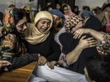 women-mourn-their-relative-mohammed-ali-khan-a-student-who-was-killed-during-an-attack-by-taliban-gunmen-on-the-army-public-school-at-his-house-in-peshawar