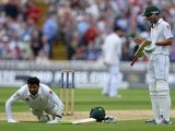 Azhar Ali celebrates by doing press-ups after reaching his century. PHOTO: AFP