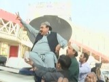 Awami Muslim League leader Sheikh Rashid Ahmed makes victory sign as he addresses party workers at Rawalpindi's Committee Chowk on Friday, October 28. SCREENGRAB