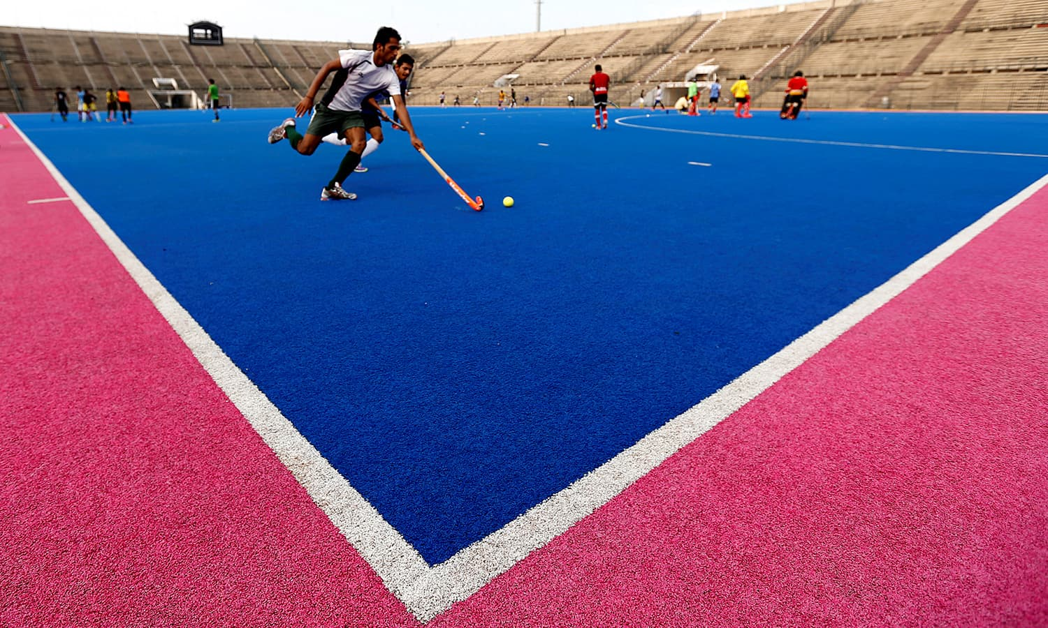 hockey-players-train-at-the-gaddafi-field-hockey-stadium-in-lahore-2