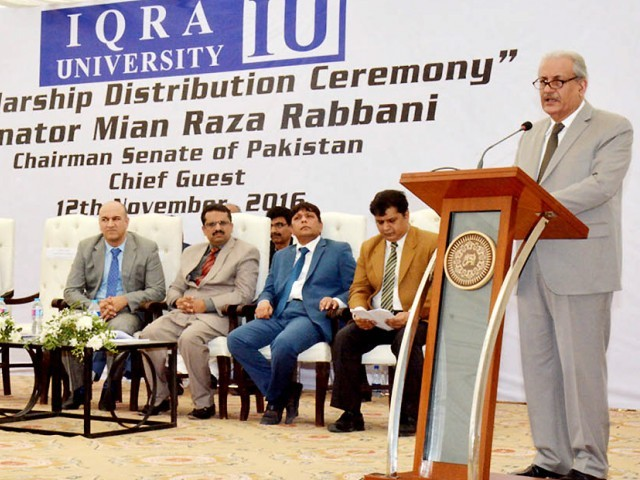 Chairman Senate Mian Raza Rabbani addressing to the scholarship distribution ceremony at IQRA University. PHOTO: NNI