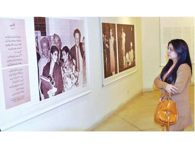 A woman admires artworks on display at Alhamra for Faiz International Festival. PHOTO: APP