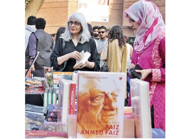 Visitors skim through books on sale during the Faiz festival at Alhamra in Lahore. PHOTO: ONLINE