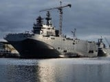 A picture shows the Sevastopol (L) and the Vladivostok warships, two Mistral class LHD amphibious vessels ordered by Russia from STX France in Saint-Nazaire, western France, on December 20, 2014. PHOTO: AFP