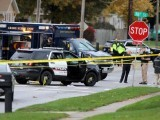 officials-investigate-the-scene-of-a-police-shooting-in-urbandale-iowa-where-one-of-two-police-officers-were-shot-and-killed-in-separate-attacks-described-as-ambush-style-in-urbandale-and-des-mo-2