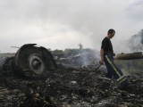 Emergencies Ministry member walks at the site of a Malaysia Airlines Boeing 777 plane crash near the settlement of Grabovo in the Donetsk region. PHOTO: REUTERS