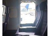 Woman opens emergency exit, jumps off plane