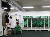employees-of-chapecoense-soccer-team-pray-inside-the-teams-locker-room-at-the-arena-conda-stadium-in-chapeco