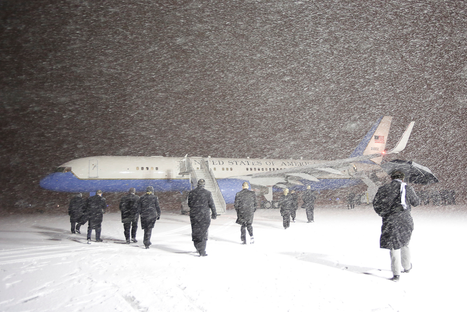 Officials walk out towards the plane carrying U.S. Vice President Joe Biden upon his arrival in a snow storm at the Ottawa International Airport in Ottawa, Ontario, Canada, December 8, 2016. REUTERS/Chris Wattie