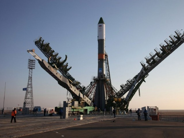 Service towers move towards the Soyuz-U carrier rocket with the cargo ship Progress MS-04 at the Russian-leased Baikonur cosmodrome in Kazakhstan on November 29, 2016. PHOTO: AFP