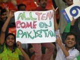 Pakistani spectators carry a placard before starting the first One Day International match between Pakistan and Zimbabwe at the Gaddafi Cricket Stadium in Lahore on May 26, 2015. PHOTO: AFP