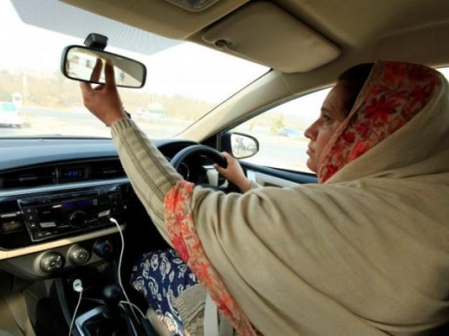 Yasmin Perveen, one of the pioneer women 'captains' of Careem, adjusts back mirror while driving her car in Islamabad, Pakistan December 7, 2016. PHOTO: REUTERS