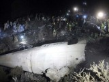 Soldiers and volunteers scour the wreckage of the crashed PIA plane in Abbottabad district. PHOTO: AFP