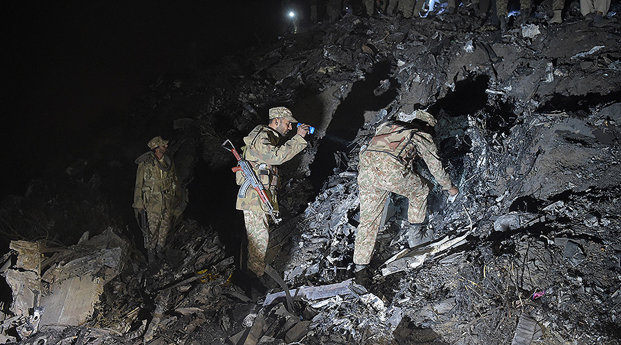 Soldiers search for victims from the wreckage of the crashed PIA passenger plane Flight PK661 at the site near Abbottabad on December 7, 2016. PHOTO: AFP