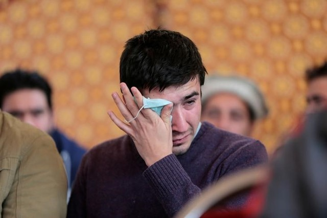 Relatives grieve as they wait for word on the collection of the remains of victims of the Pakistan International Airlines (PIA) plane crash at PIMS hospital in Islamabad, Pakistan December 8,  2016. PHOTO: REUTERS