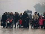 people-walk-as-they-flee-deeper-into-the-remaining-rebel-held-areas-of-aleppo