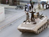 militant-islamist-fighters-take-part-in-a-military-parade-along-the-streets-of-northern-raqqa-province-3