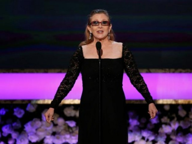 Actress Carrie Fisher introduces her mother, actress Debbie Reynolds, as the recipient of the Life Achievement Award at the 21st annual Screen Actors Guild Awards in Los Angeles, California January 25, 2015. PHOTO: REUTERS