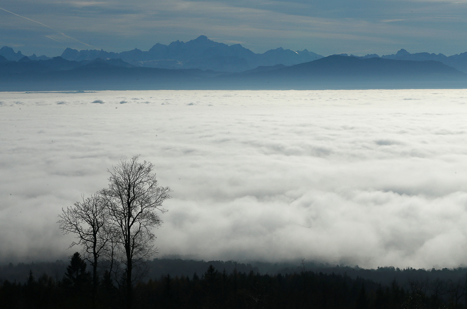 The Mont-Blanc mountain is pictured with a sea of mist on a warm winter day from St-Cergue near Geneva, Switzerland, December 9, 2016. REUTERS/Denis Balibouse