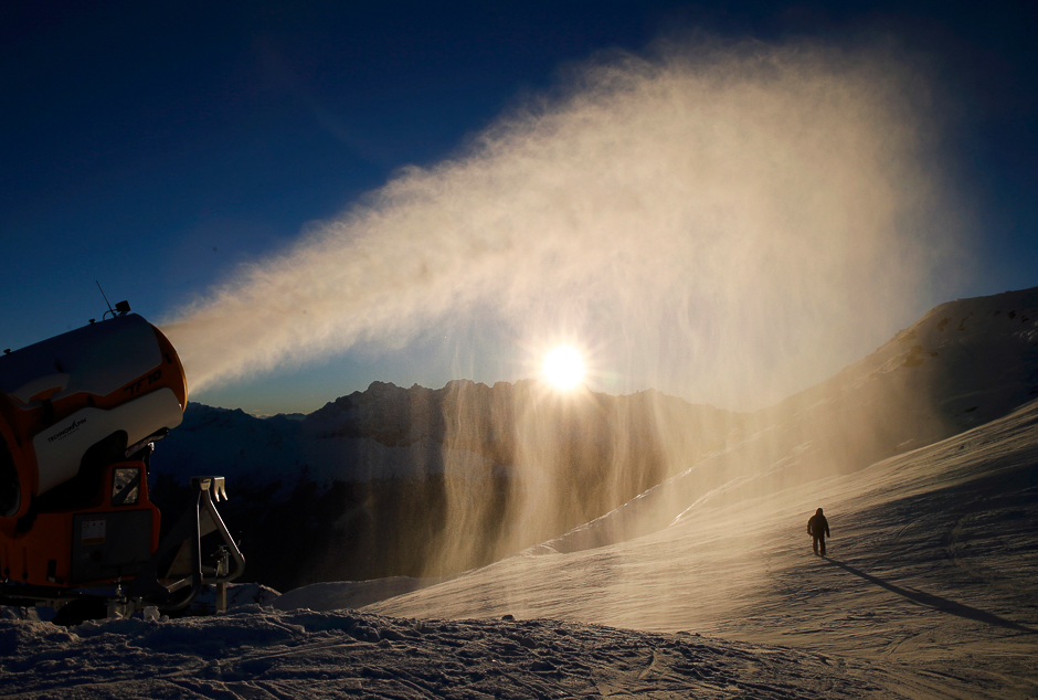 Snowmaker Jose Martinez of the Verbier ski resort checks the artificial snow making machine in Verbier, Switzerland, November 28, 2016. REUTERS/Denis Balibouse