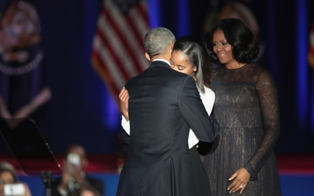 President Barack Obama greets his wife Michelle and daughter Malia following his farewell speech to the nation on January 10, 2017 in Chicago, Illinois. PHOTO: AFP