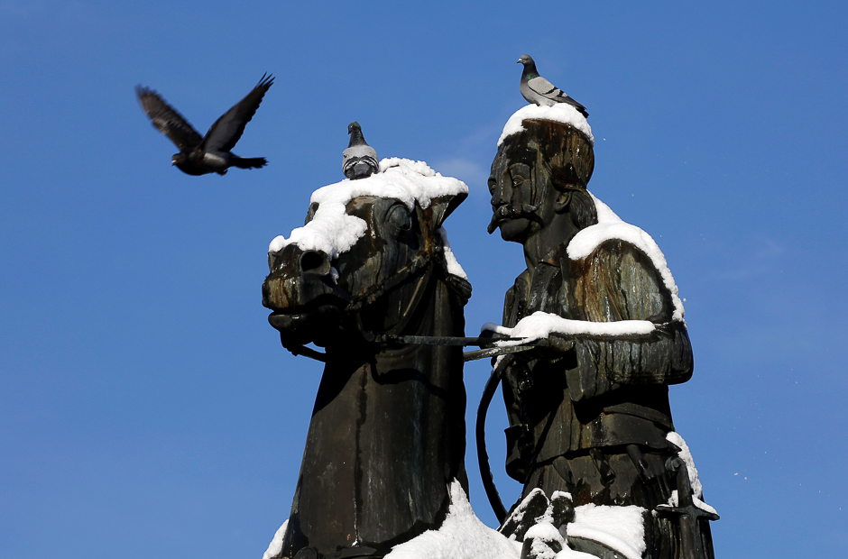 Pigeons perch on the statue of Greek Independence war hero Georgios Karaiskakis following a rare snowfall, in Athens, Greece. PHOTO: REUTERS