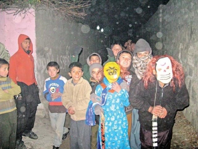 Children go door to door during the winter season performing a traditional play dressed in different costumes in Gilgit. PHOTO: EXPRESS
