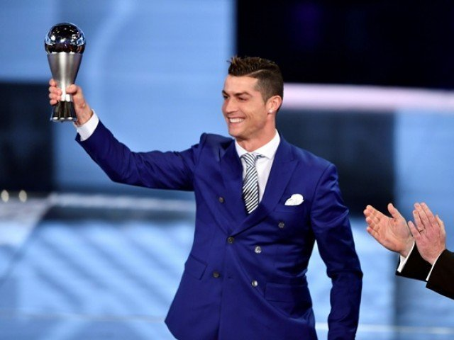 Real Madrid and Portugal's forward Cristiano Ronaldo (L) holds his trophy after winning the The Best FIFA Men s Player of 2016 Award during The Best FIFA Football Awards ceremony, on January 9, 2017 in Zurich. PHOTO: AFP