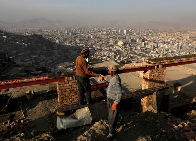 afghan-men-build-a-house-on-a-hilltop-overlooking-kabul-afghanistan