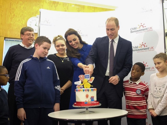 The Duke and Duchess of Cambridge cut a cake, as the London Centre marks its one year anniversary on Wednesday. PHOTO: KENSINGTON PALACE