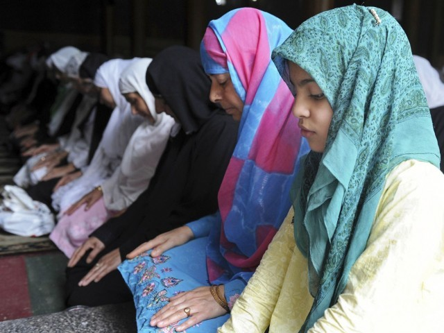 A file photo of Kashmiri women praying in a mosque. PHOTO: AFP