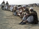 men-fleeing-a-military-offensive-in-south-waziristan-line-up-while-waiting-for-their-turn-to-collect-handouts-at-a-distribution-point-for-idps-in-dera-ismail-khan-2-2-2-2-3