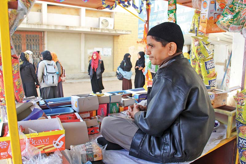 Muhammad Faizan Paracha has set up a small tuck shop, 'Crunchy Munchy', under the building of the social work department at the University of Karachi. PHOTO: AYESHA MIR/EXPRESS