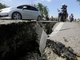 motorcyclists-pass-a-damaged-section-of-a-road-following-an-earthquake-in-meuredu-pidie-jaya-in-the-northern-province-of-aceh-3-2-2