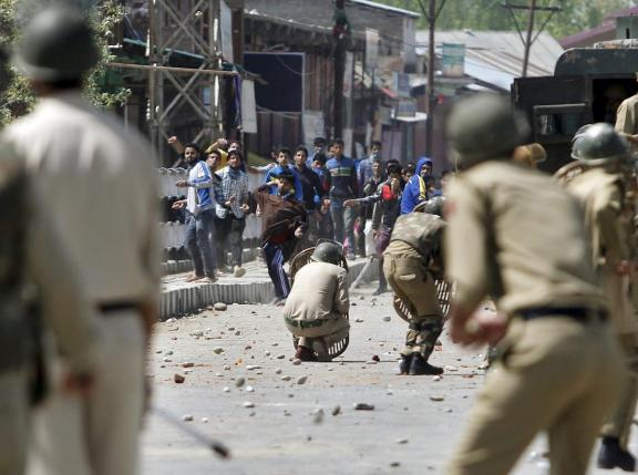 kashmiri-protesters-throw-stones-towards-indian-policemen-during-a-daylong-protest-strike-in-narbal-north-of-srinagar-2-2