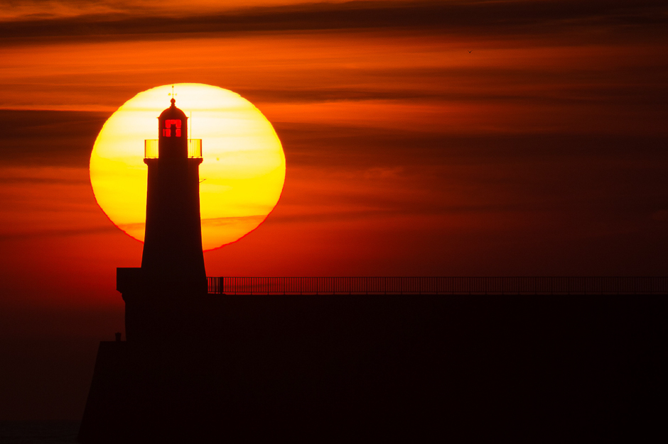 A lighthouse on a pier at sunset in Les Sables d'Olonne, western France. PHOTO: AFP
