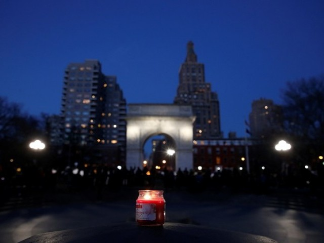 A candle is seen as demonstrators gather at Washington Square Park to protest against U.S. President Donald Trump in New York US, January 25, 2017. PHOTO: REUTERS