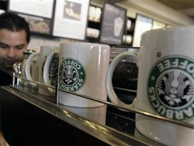 Starbucks chairman says company is in business to inspire, nurture human spirit regardless of religion. PHOTO: REUTERS