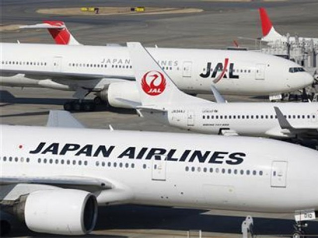 Japan Airlines aircrafts are parked on the tarmac at Haneda Airport in Tokyo February 4, 2013. PHOTO: REUTERS