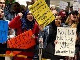 dozens-of-pro-immigration-demonstrators-cheer-and-hold-signs-as-international-passengers-arrive-at-dulles-international-airport-in-chantilly-virginia-2