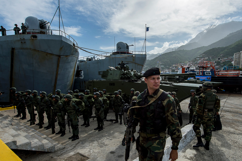 Venezuelan soldiers prepare to embark for military maneuvers at the port of La Guaira, Venezuela. PHOTO: AFP